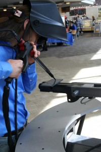 During the Connections Fair, the Welding Club showcased a piece of equipment used to simulate welding. (Photo by James Healy)