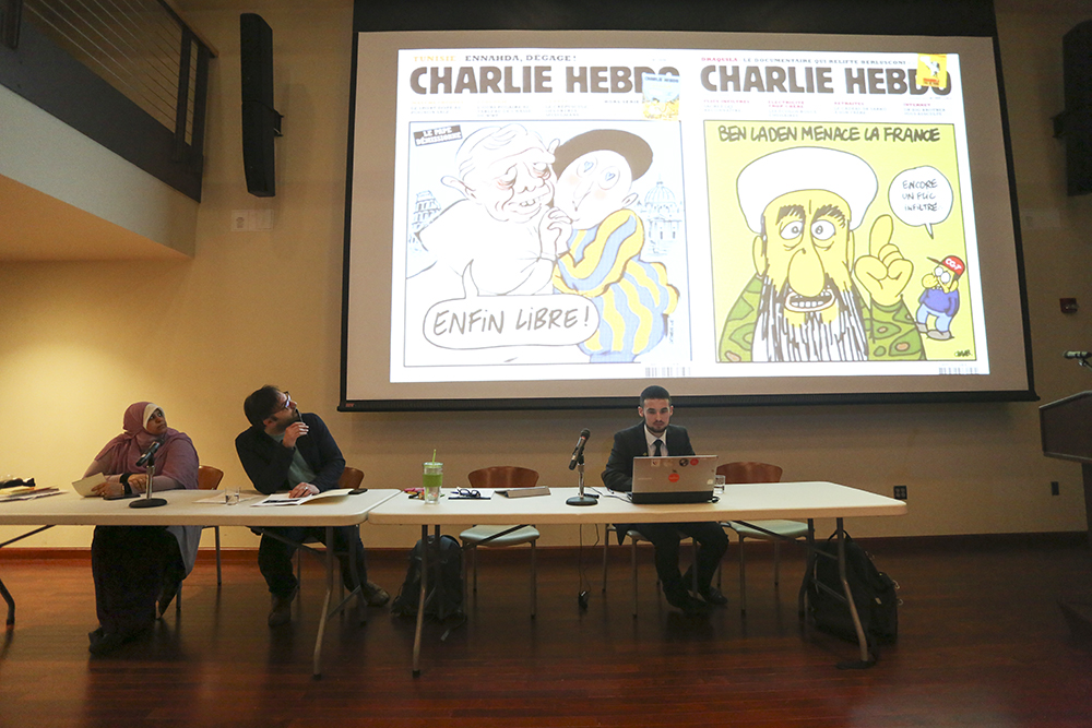 A+video+about+the+Charlie+Hebdo+controversy+preceded+the+panel+speakers.+%28Photo%3A+Chris+Juhn%2FCity+College+News%29