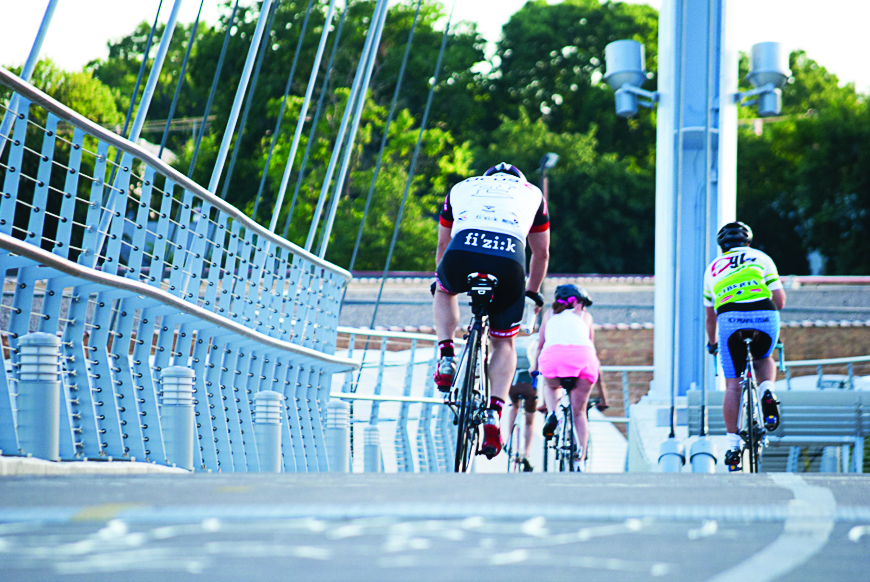 Cyclists+cross+the+Martin+Olav+Sabo+Bridge+on+the+Midtown+Greenway.+Photo+credit%3A+Benjamin+Pecka