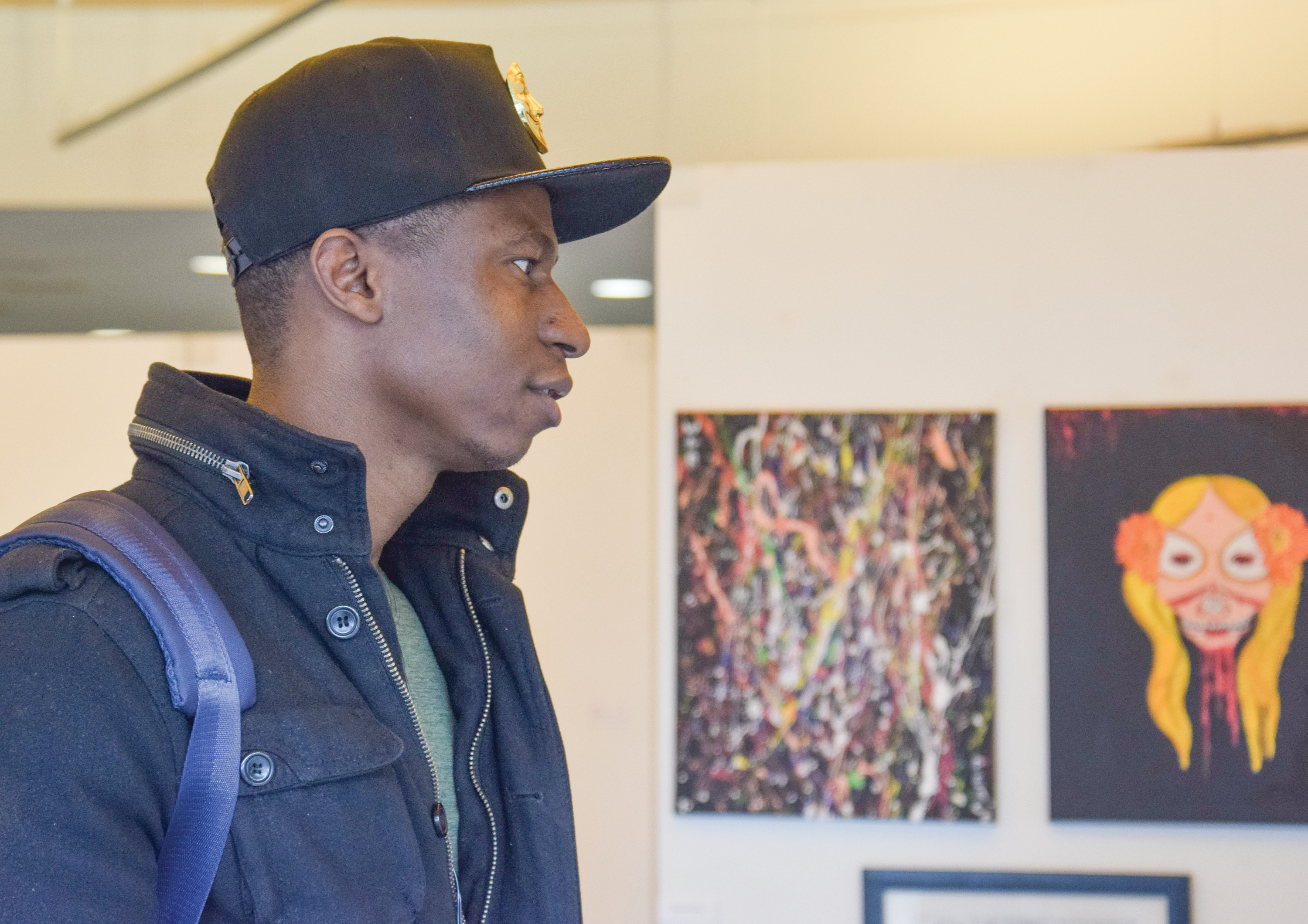 Students view artist pieces at the Associate of Fine Arts Exhibit