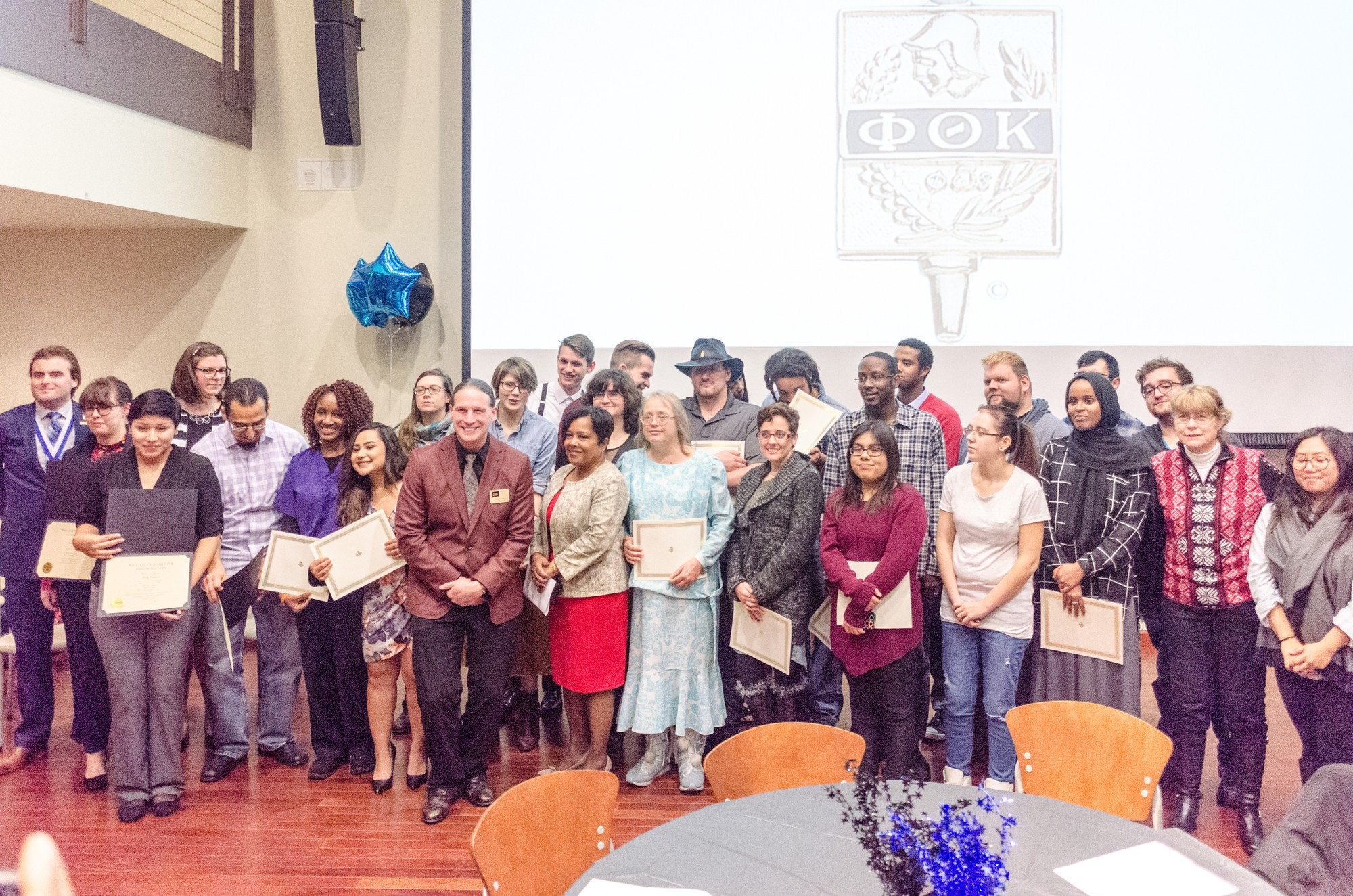 Inductees pose for photos after receiving their Phi Theta Kappa certificates. Photo credit: Benjamin Pecka