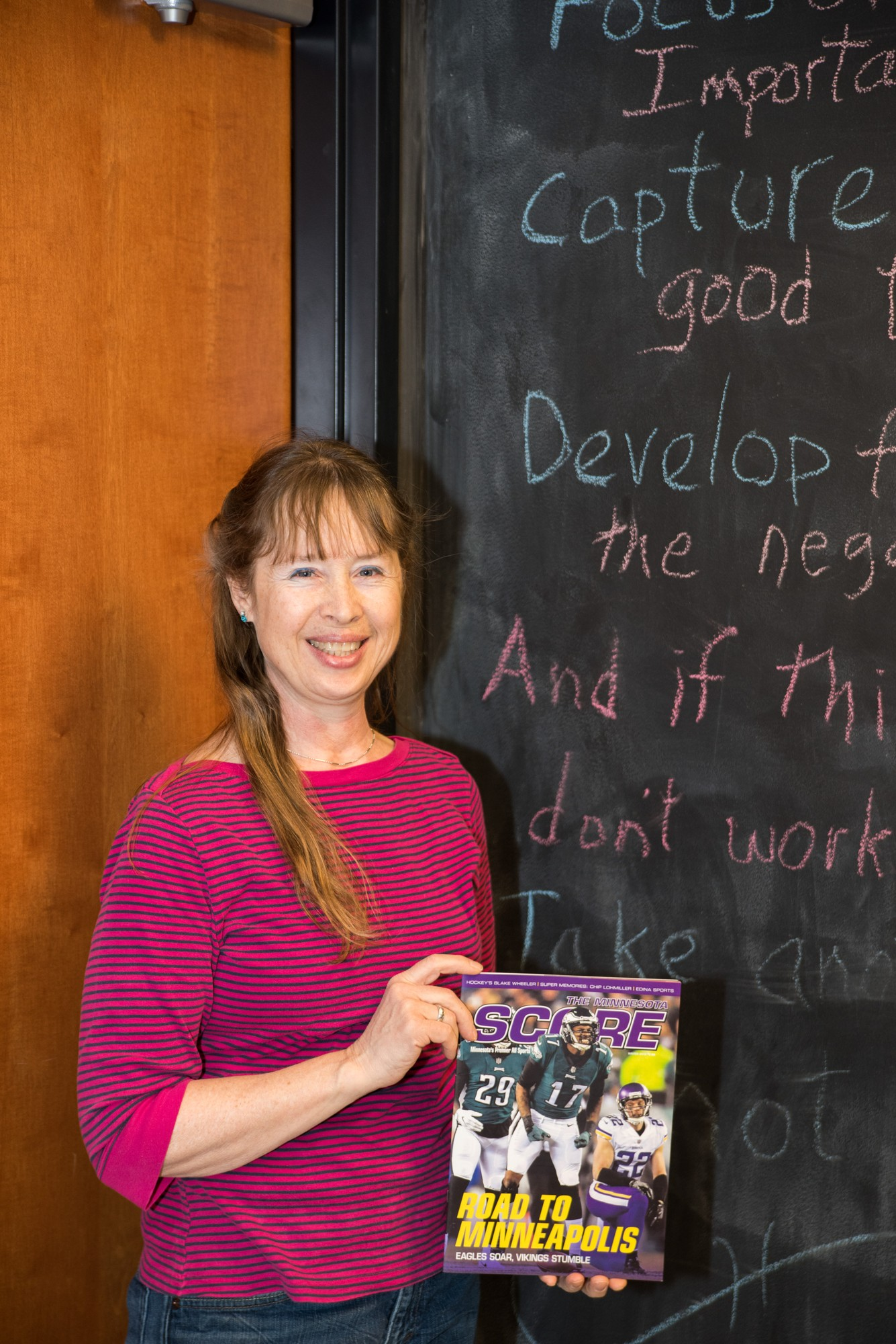 Minneapolis, MN - 2/12/2018 - Marilyn Indahl displays a copy of Minnesota Score that her pictures of the Stefon Diggs and the Minnesota Miricle were published in.  (Mark Kuhn/MCTC)
