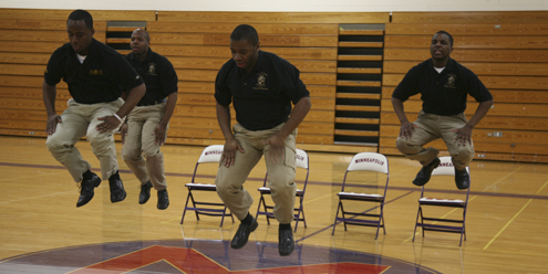 Members of the Univ. of Minn. Alpha Phi Alpha Fraternity step performance group perform in the gymnasium on Jan. 12, 2011.
