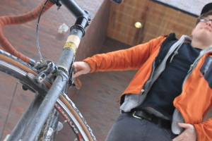 Rude gets ready to ride his bike in subzero temperatures.