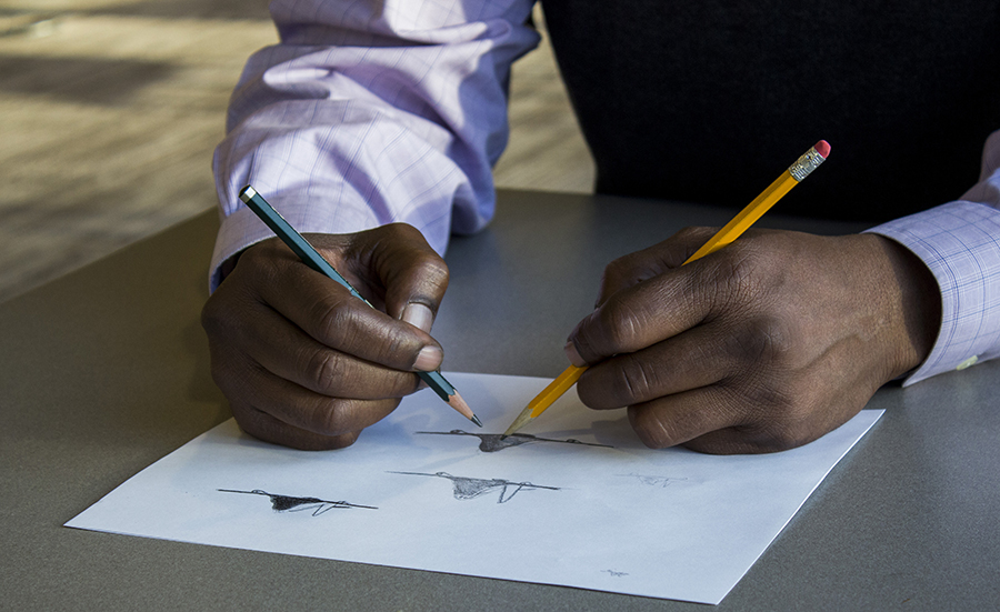 Coleman can draw a shape with one hand and shade with the other at the same time.