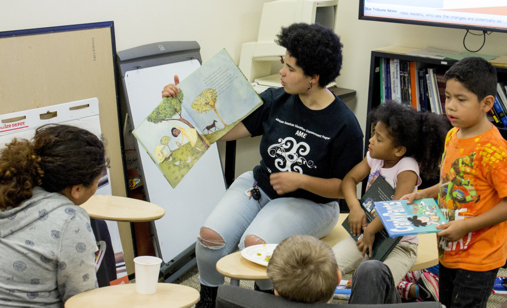 AME Student Coordinator Sarah Sharp reads to kids at the event on October 8th, 2015 at MCTC in Minneapolis, MN. Photo by Brady O'Neel/ City College News