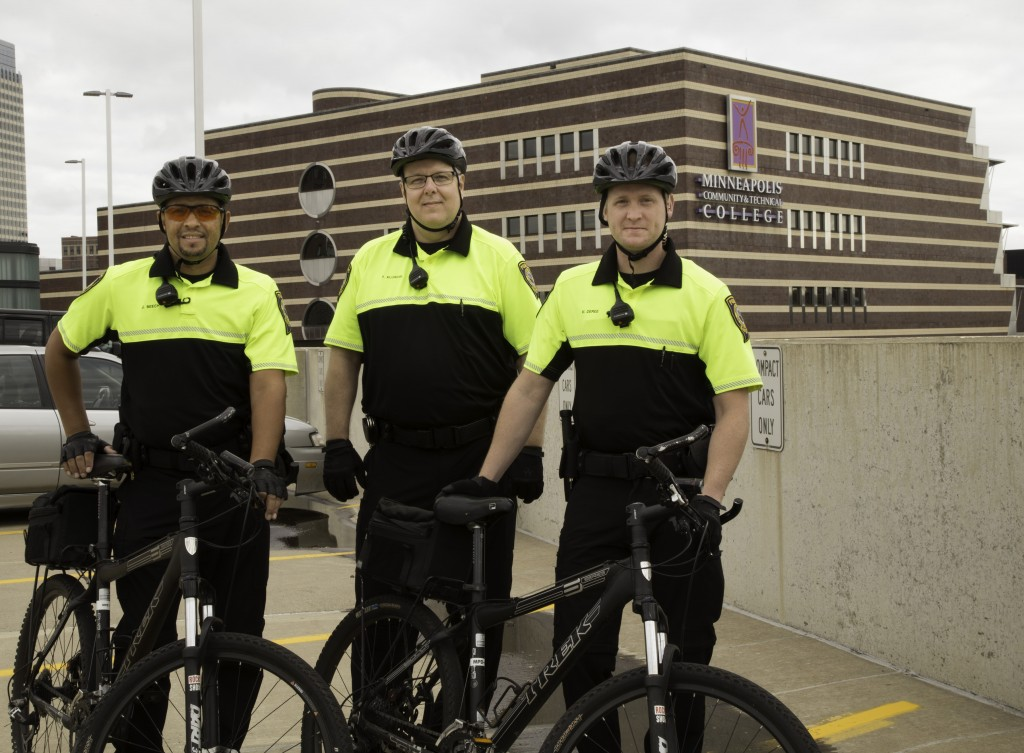 """Minneapolis, MN - 9/28/2016 - Jacques Beech Public Safety Officer, Tim Kluxdal, Public Safety Officer and Mark DeRee, Public Safety Supervisor, regularly patrol the campus grounds and parking ramp on bikes. The bike unit currently has two bicycles in service, but five more will join the force, through a grant made possible by the Target Corporation."""" (Jessiena Lake/MCTC) Photo credit: Jessiena Lake"""