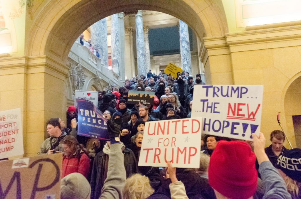 Trump+supporters+are+in+front%2C+counter-protesters+are+up+the+stairway.+Photo+credit%3A+Benjamin+Pecka
