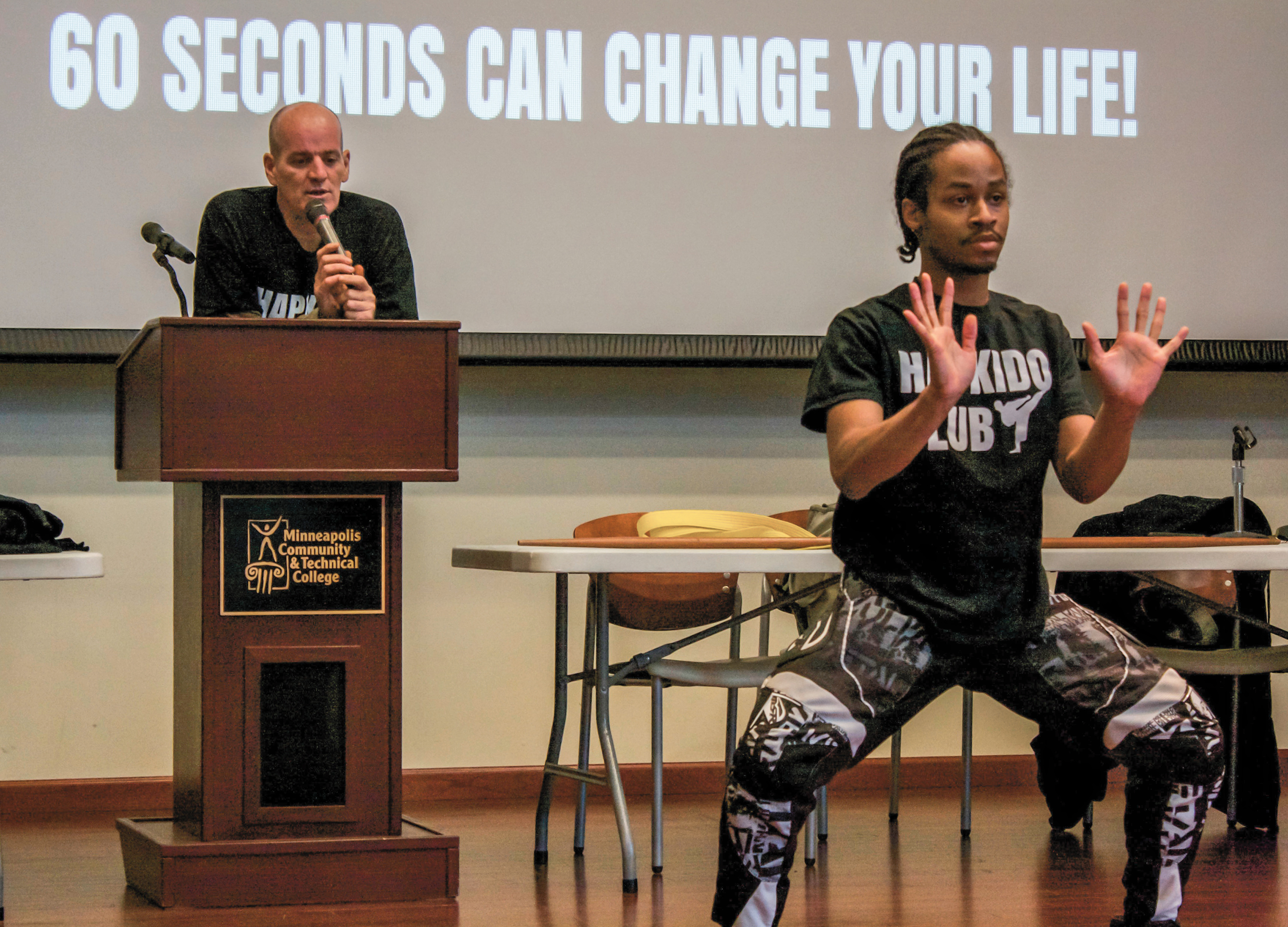 Jezel Henry shows off different Hapkido poses while John Murphy tells a story. Photo by J.D. Duggan