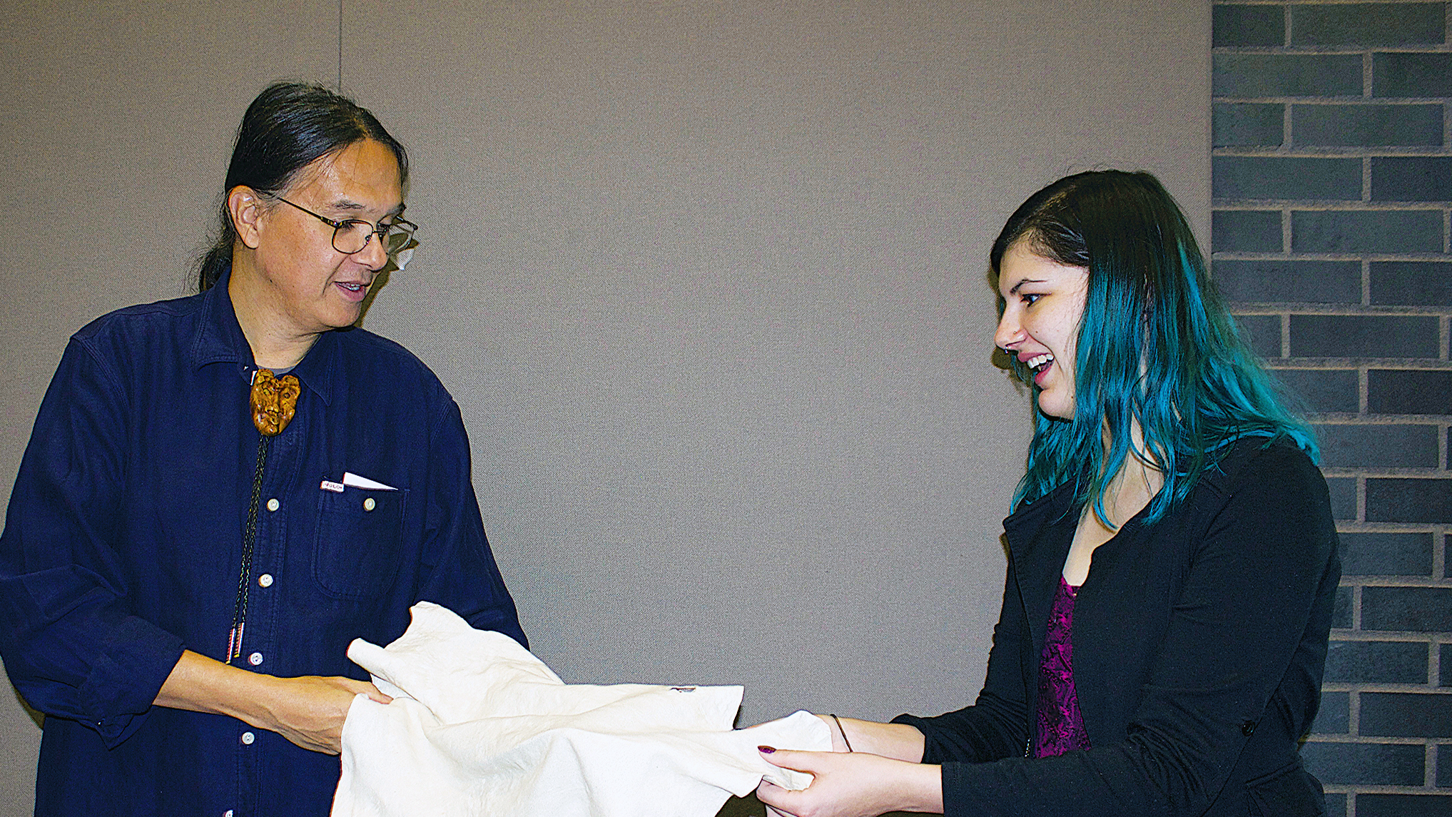 Alicia De La Cruz and Professor Jeffrey Chapman look at a shammy Chapman made from leather. Photo credit: Emily Lazear